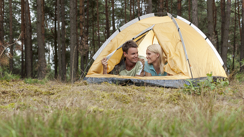 Couple camping in the woods