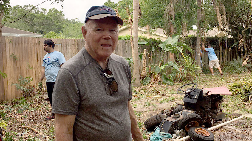 James Palmer, a Vietnam War-era Army private, monitors the clean-up of his property by Operation Code Vet.