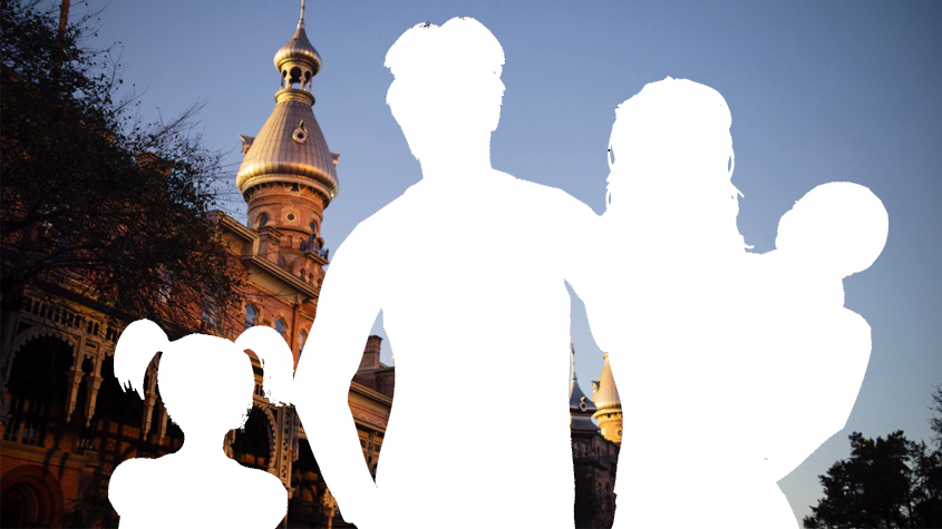 Family silhouette against UT minarets