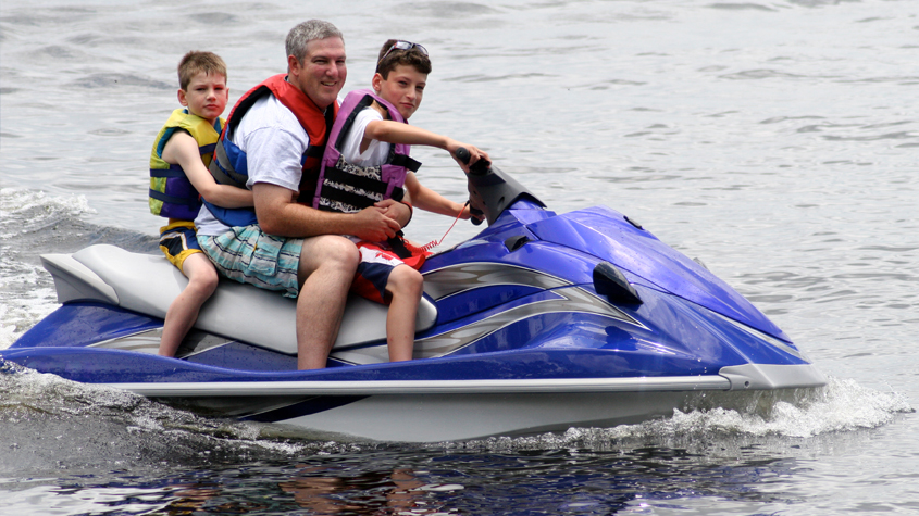 Dad and kids on a jet ski